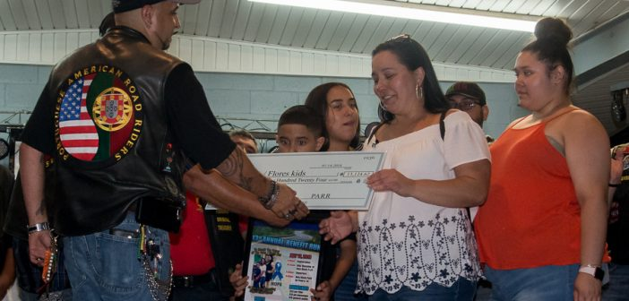 PARR Presents Check to Paiva/Flores Children