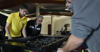 "Players playing ""matraquilhos"" (table football)"