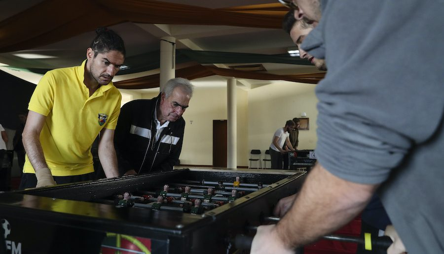 """Players playing """"matraquilhos"""" (table football)"""